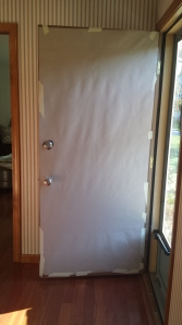 Cover your door with brown (or white) paper.  This is to hide whatever color door you have from showing through.