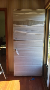 Continue taping the strips to the entire door.
